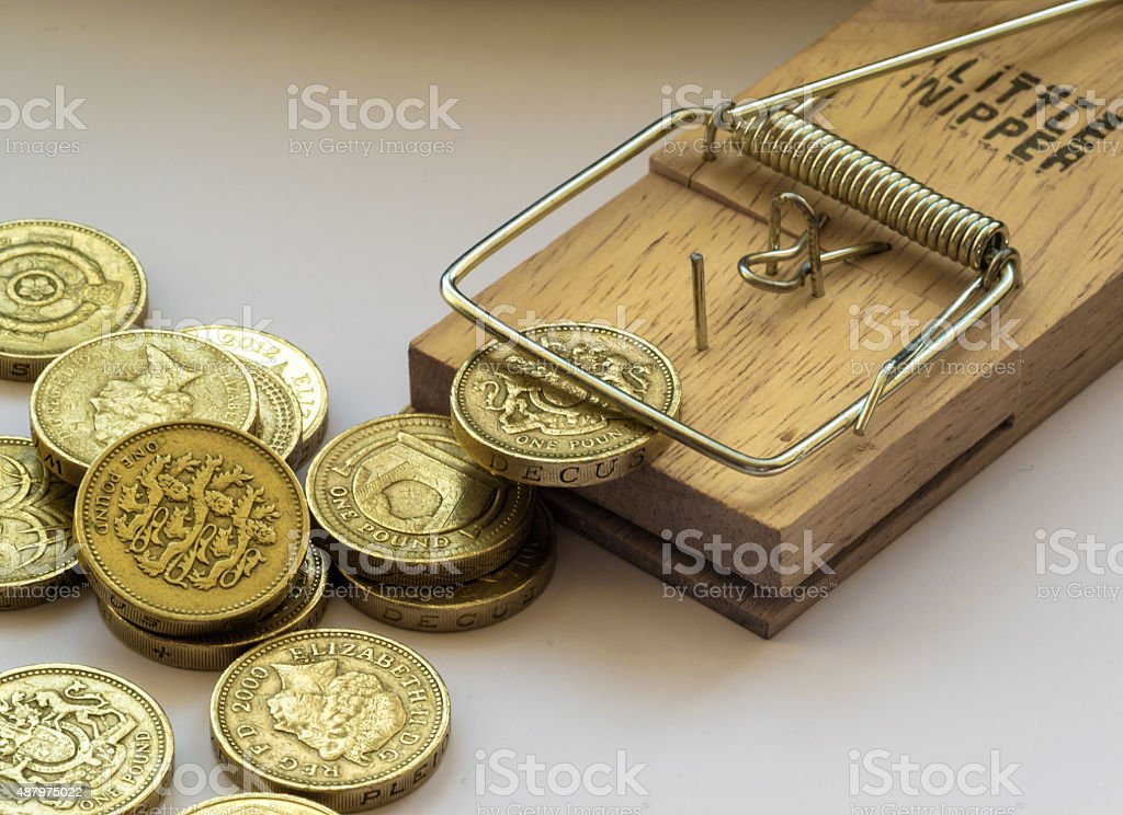Mouse Trap Catches a British Pound Coin stock photo