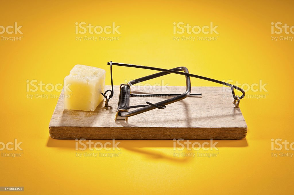 Mousetrap with hard cheese isolated on yellow, side view stock photo