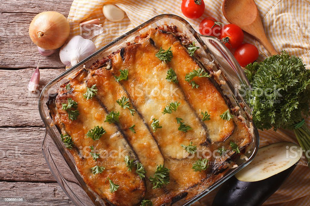 moussaka closeup in baking dish and ingredients. Horizontal top stock photo