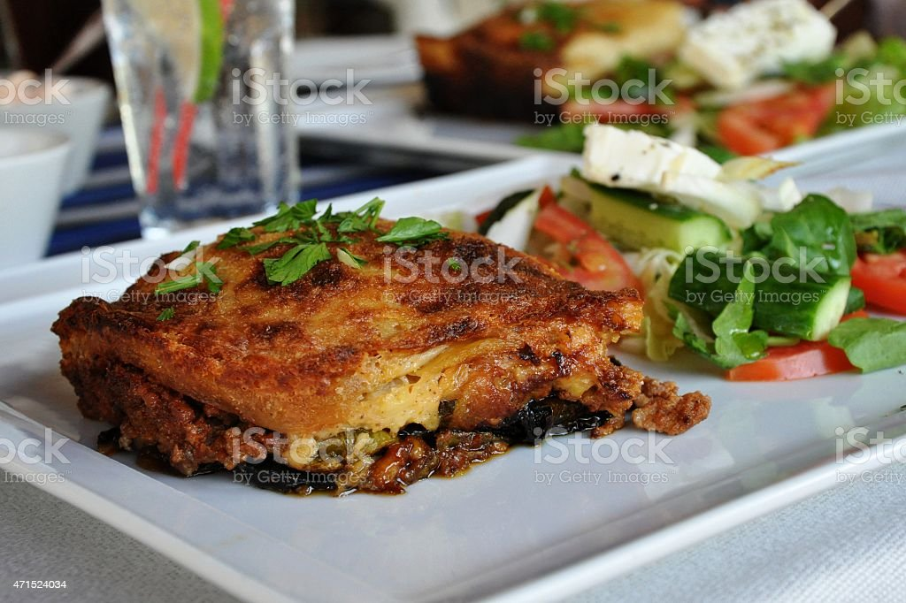 Moussakas and salad stock photo