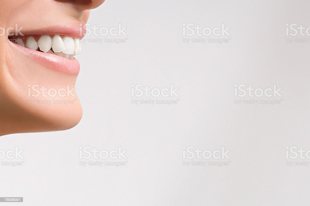 Mouth of a woman smiling 免版稅 stock photo