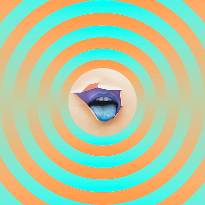 istock mouth showing tongue in the middle of circles 1125575753