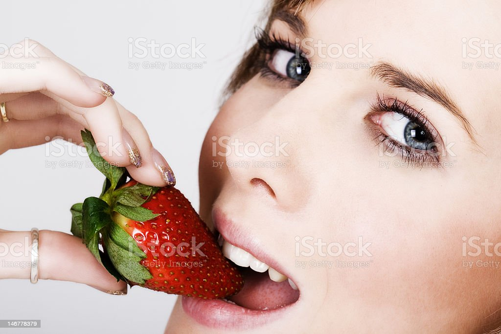 Mouth with fresh strawberry royalty-free stock photo
