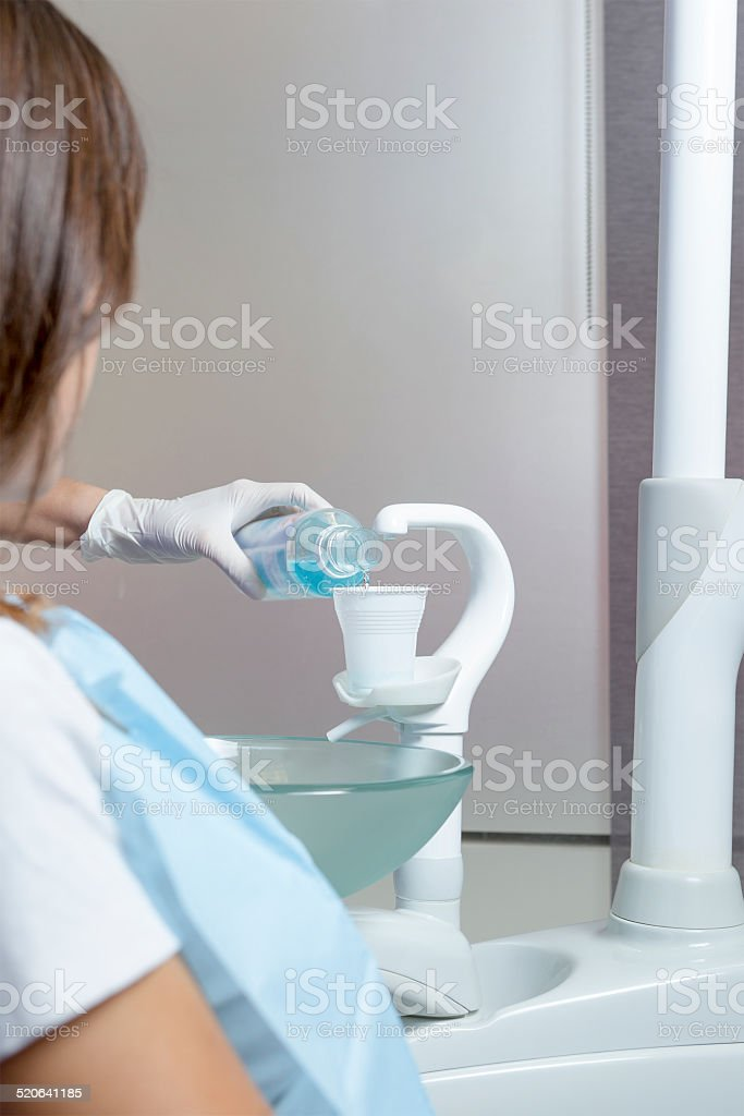 mouthwash and plastic cup stock photo