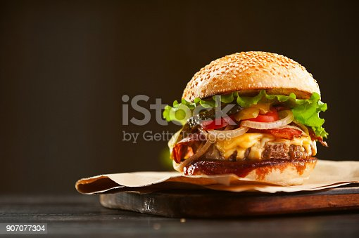 istock mouth-watering delicious homemade burger used to chop beef on the wooden table. 907077304