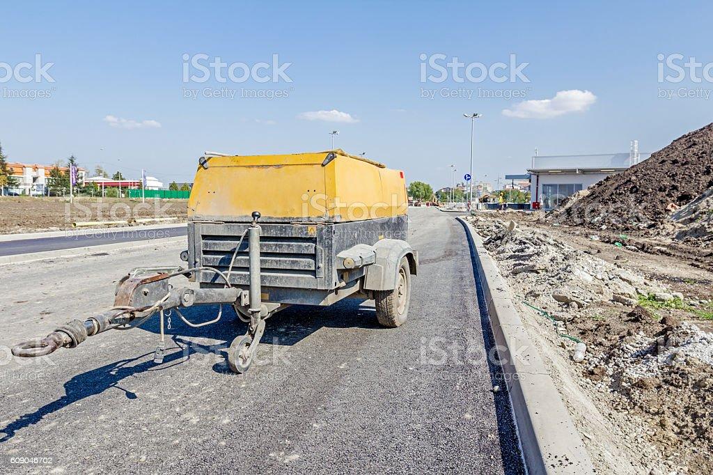 Movable compressor for handheld jackhammer stock photo