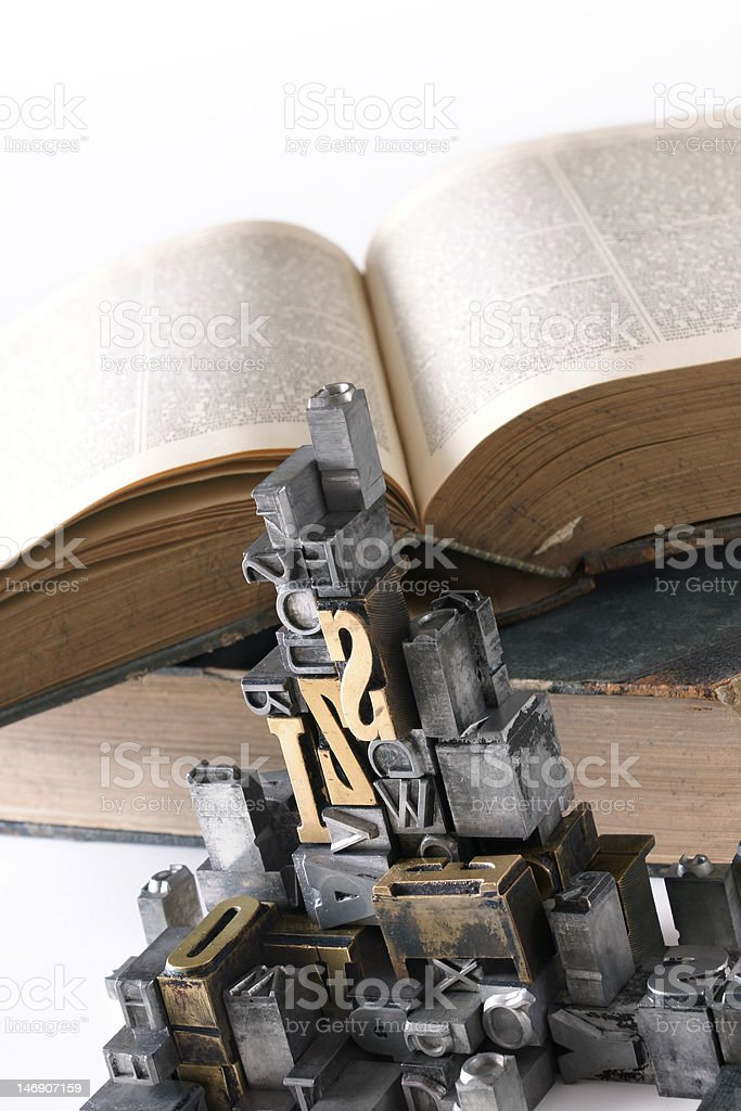 movable type with old book royalty-free stock photo