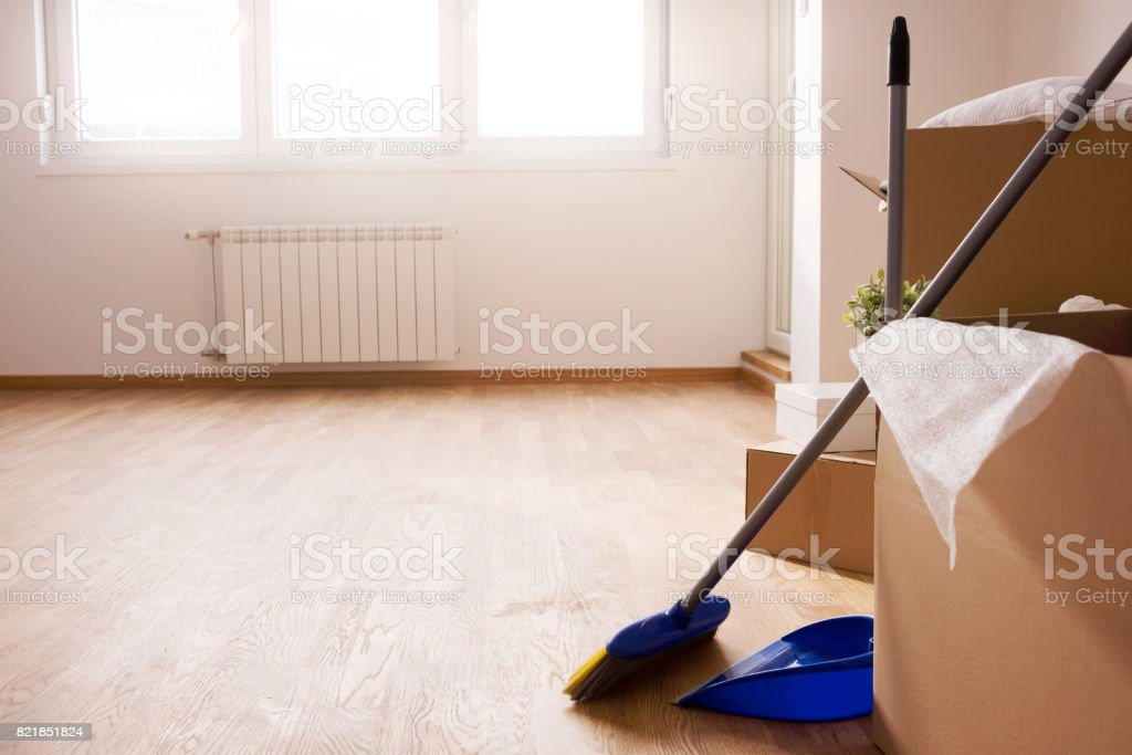 Move. Cardboard boxes and cleaning things for moving into a new home stock photo