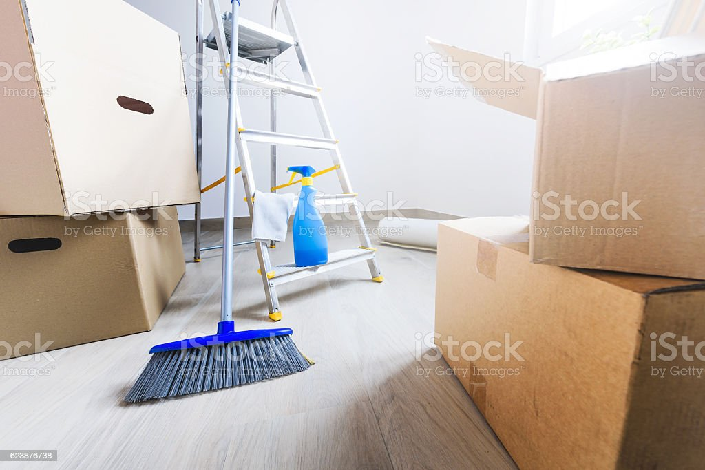 Move. Cardboard boxes and cleaning things stock photo