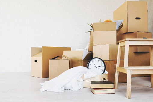 istock Move. Cardboard boxes for moving into a new home 948694056