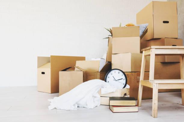 move. cardboard boxes for moving into a new home - oggetti personali foto e immagini stock