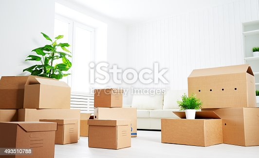 istock move. lots of cardboard boxes in empty new apartment 493510788