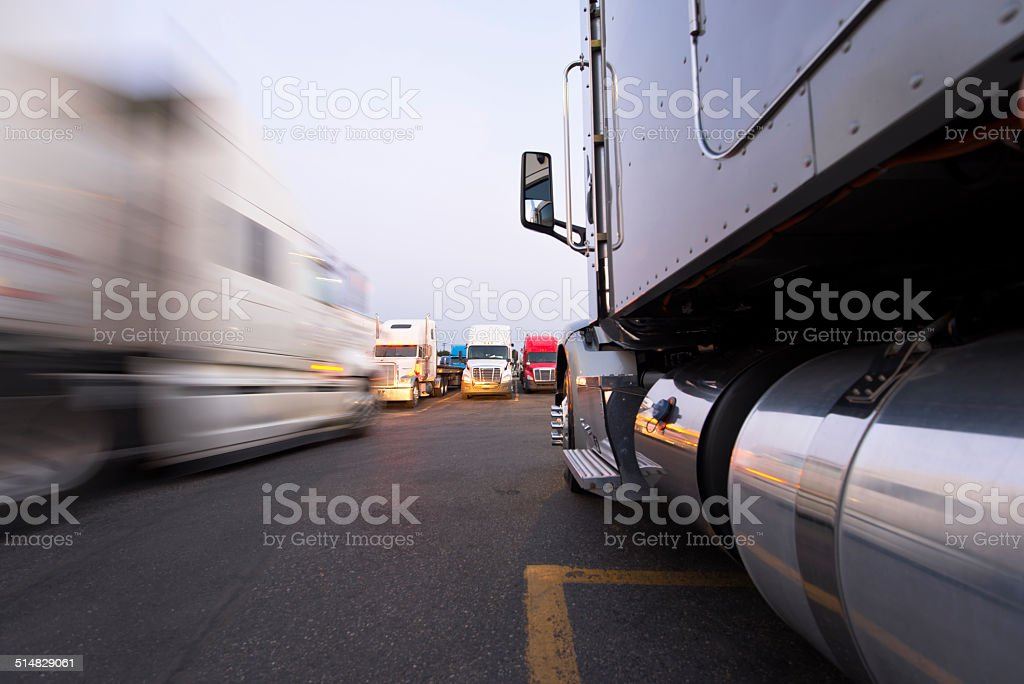 Movement and parking of semi trucks on the truck stop stock photo