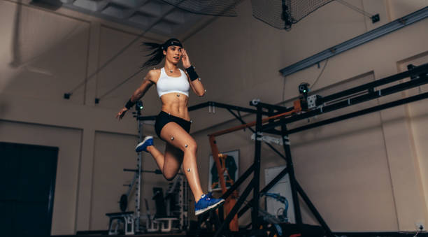 Movement and performance monitoring of runner in biomechanical lab stock photo
