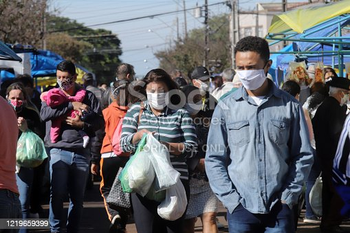 Apucarana / Paraná / Brazil - April 19, 2020 - Movement at the open market on Saturday morning in Apucarana. People all wearing a mask, to protect themselves from covid-19, coronavirus