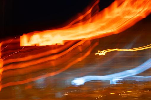 824108398 istock photo Movement blur of car light at night. 1079706032