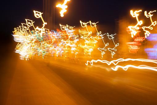 824108398 istock photo Movement blur of car light at night. 1079772904