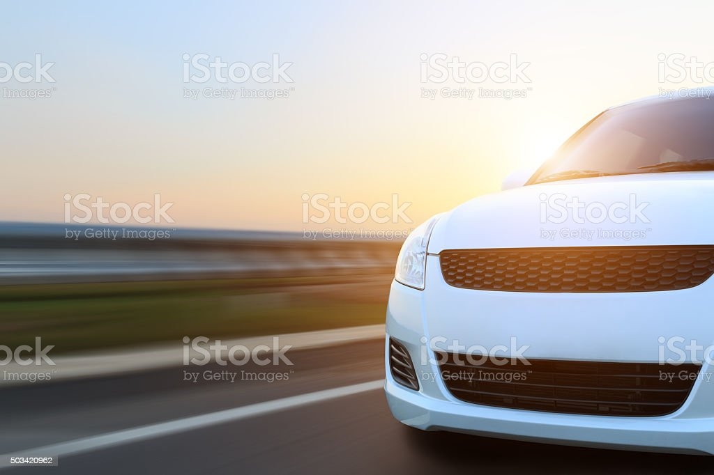movement car speed on asphalt at sunset stock photo