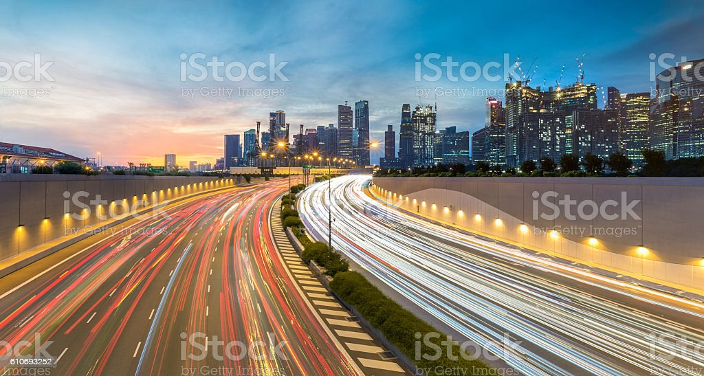 Movement of car light with Singapore cityscape skyline during sunset stock photo