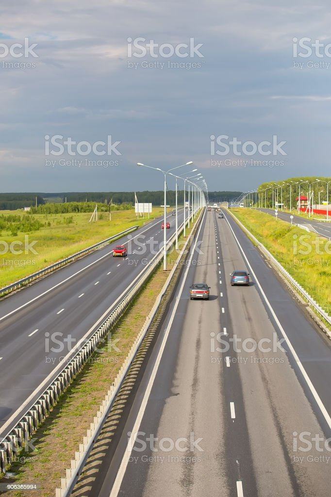 movement of cars on multilane highway stock photo