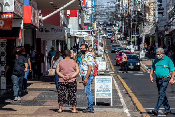 Movement of consumers and vehicles on Sao Luiz street, one of the main commercial streets in Marilia, during the limited opening of commercial establishments. in the prevention of Covid-19, in downtown of Marilia, in the central-west region of S stock photo