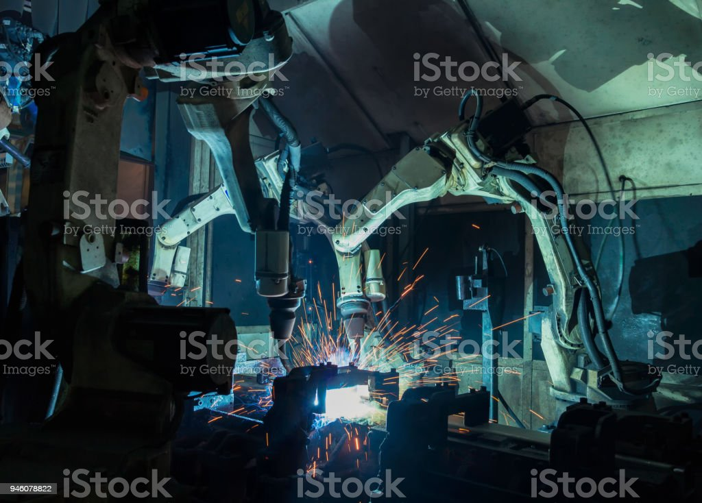 Movement of robot welding in car factory stock photo