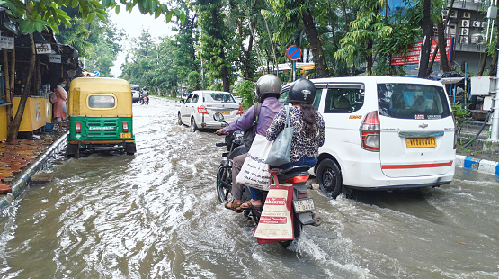 Kolkata, 07/30/2021: Movement of traffic through flooded street of Saltlake Sector V after a torrential monsoon rain disrupted citylife and flooded several parts of city.