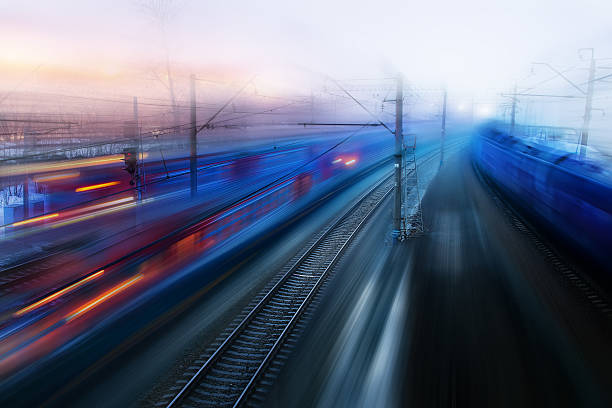 movement of trains in  ways of evening twilight fog spring - rail stock photos and pictures
