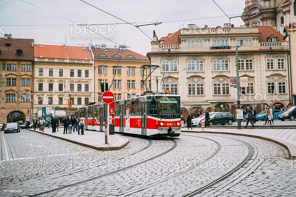 Movement of tram on the street Malostranske namesti in Prague stock photo