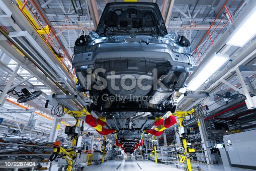 1069360792 istock photo Movement of vehicles along the production line at the plant. Car Assembly shop. Car Assembly by parts 1072287404