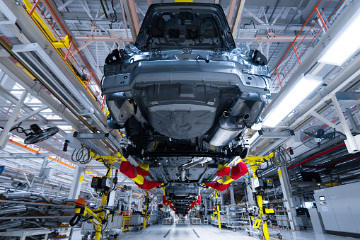istock Movement of vehicles along the production line at the plant. Car Assembly shop. Car Assembly by parts 1072287404