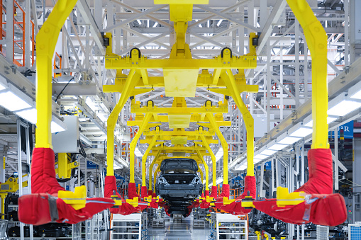 istock Movement of vehicles along the production line at the plant. Car Assembly shop. Car Assembly by parts 1083495946