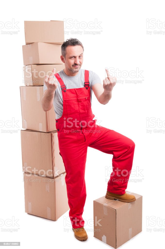 Mover guy standing on boxes showing obscene gesture stock photo