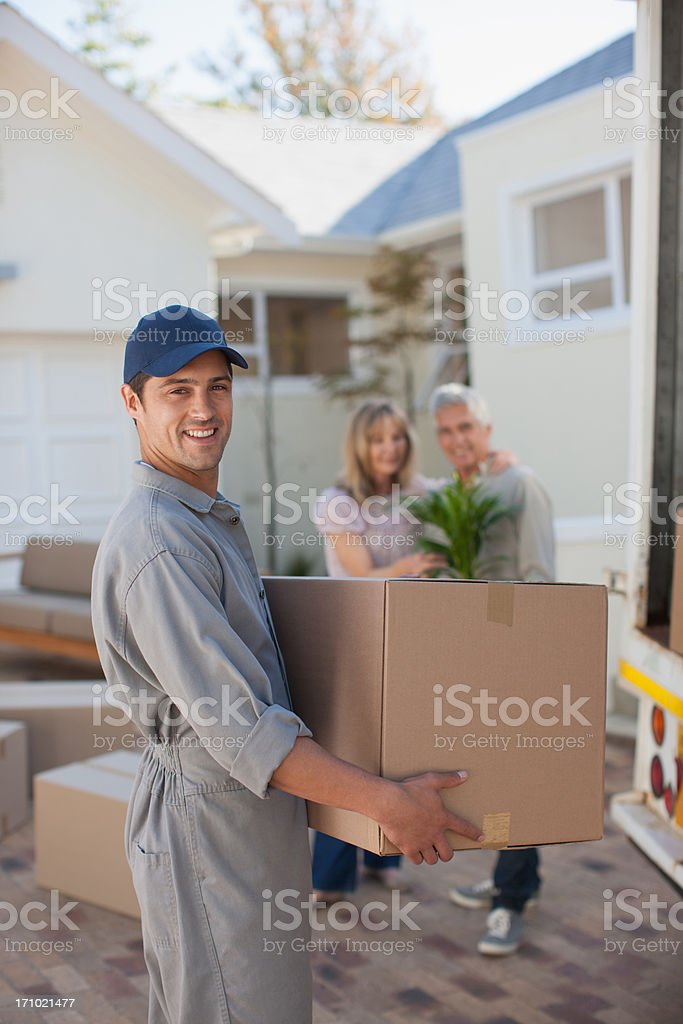 Mover helping couple move into new home royalty-free stock photo