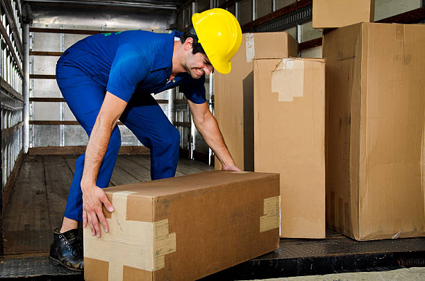 Mover Lifting a Box Incorrectly stock photo