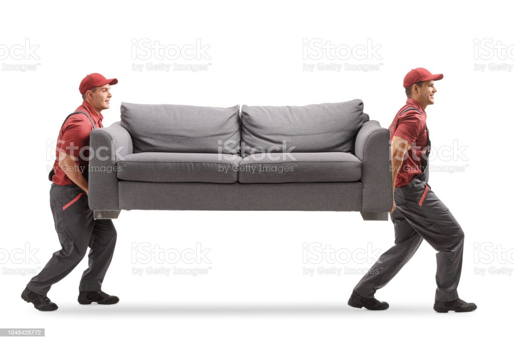 Movers carrying a couch stock photo