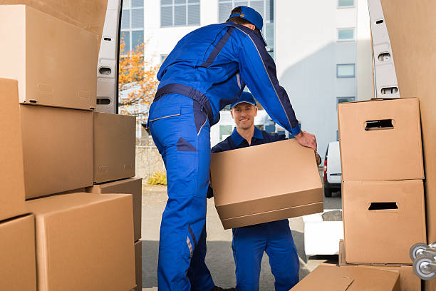movers carrying sofa outside truck on street - relocation stock photos and pictures