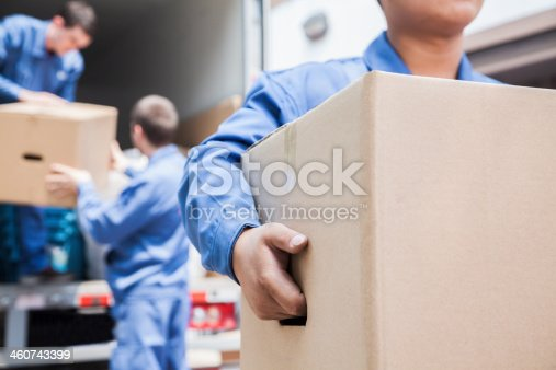 istock Movers unloading a moving van 460743399