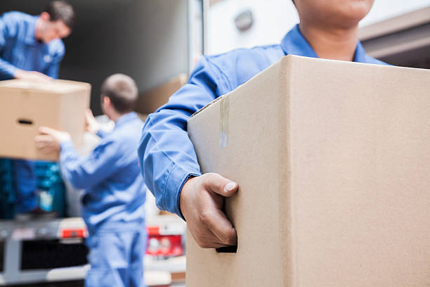 Movers unloading a moving van stock photo