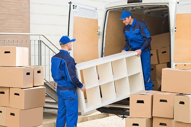 movers unloading furniture from truck - umzug transport stock-fotos und bilder