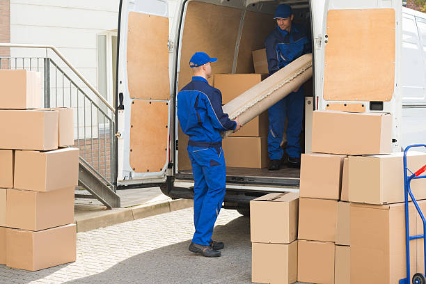 movers unloading rolled up rug from truck - umzug transport stock-fotos und bilder