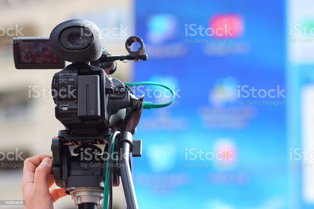 Movie camera filming blurred background stock photo
