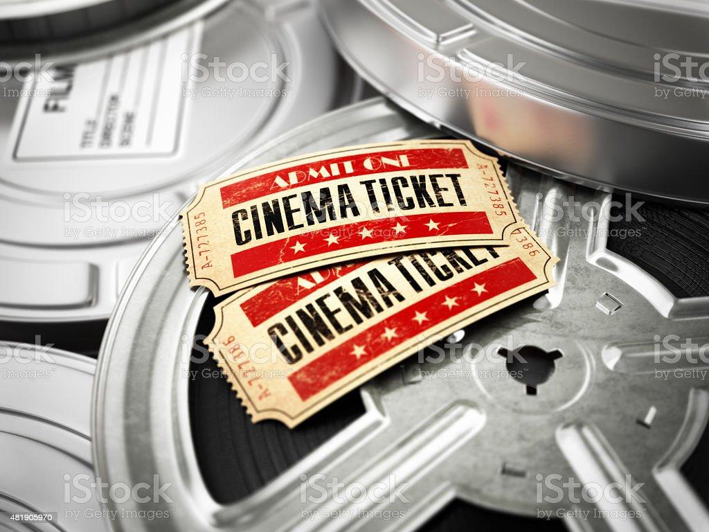 Movie, cinema vintage concept. Tickets on retro film reels stock photo