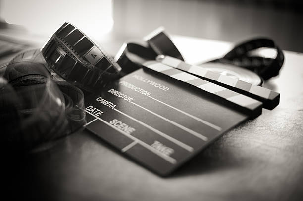 movie clapper board and filmstrip selective focus - audition stock photos and pictures