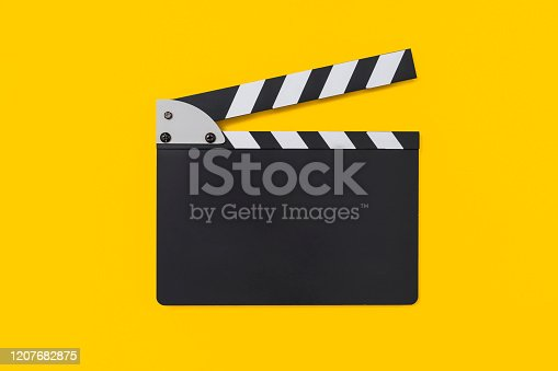 Movie clapper board on yellow background , with copy space