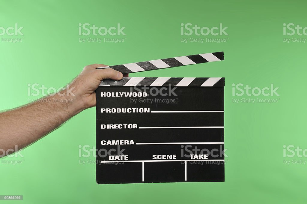 A movie clapper held in front of a green screen  royalty-free stock photo