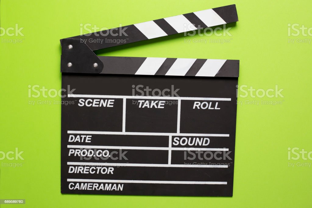 movie clapper on green background stock photo