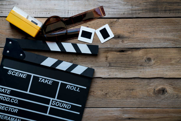 movie clapper on wood table ; film, cinema and vedio photography concept stock photo