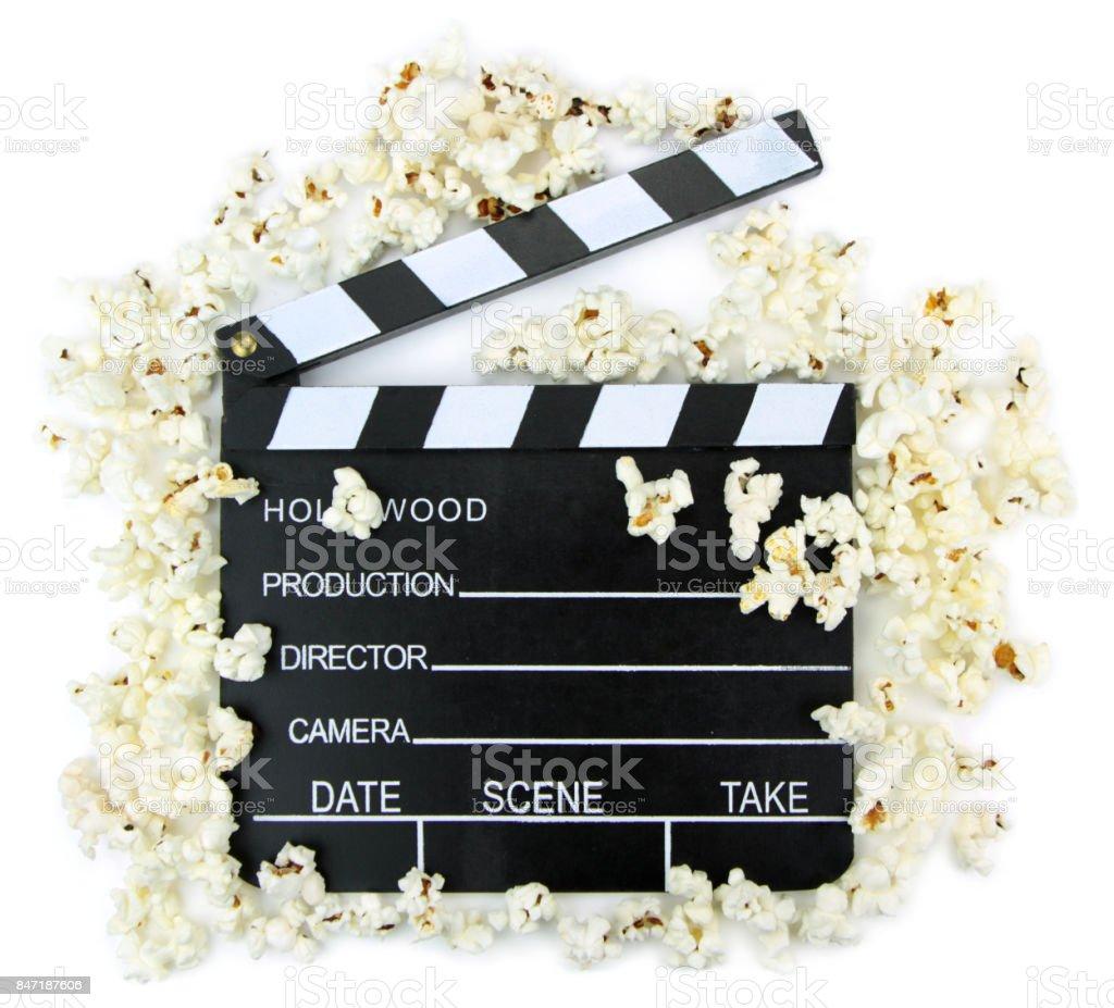 Movie clapper with popcorn stock photo