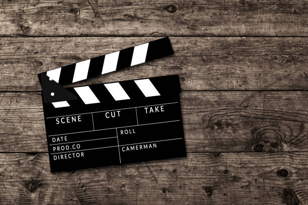 Movie clapperboard on wooden table background. stock photo
